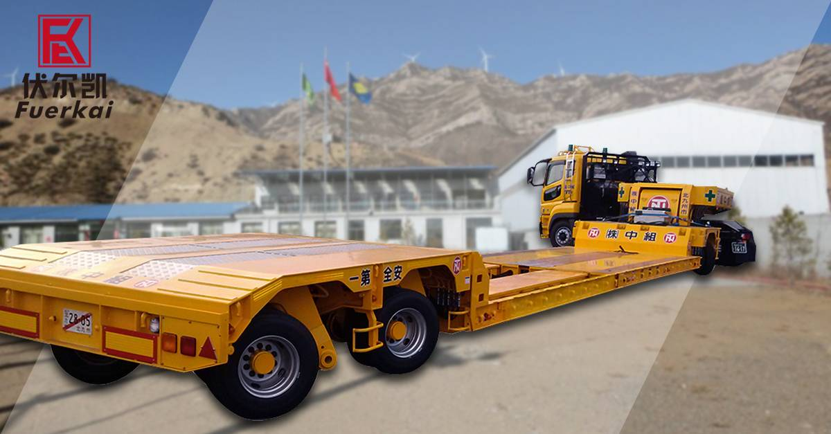 Congratulations!Vulacan 3 axles low bed semi trailer is put into use at construction site
