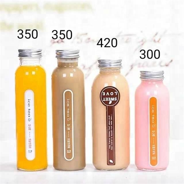 350ml 11oz clear empty tall round drinking packaging glass bottles with screw cap for juice beverage tea milk Featured Image