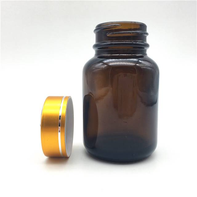 Capsule Glass bottle with plastic golden lid