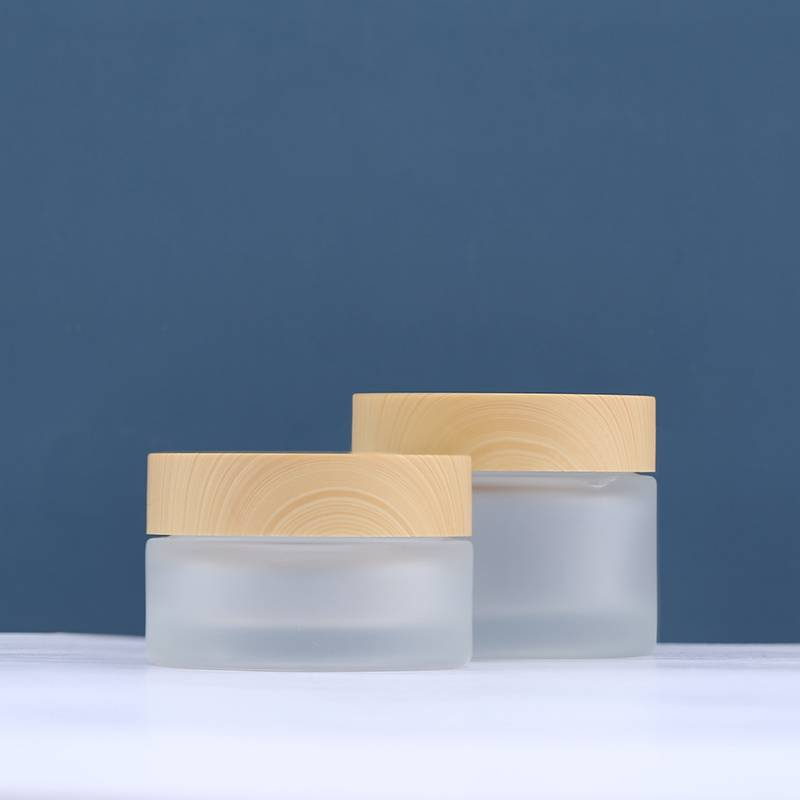 wholesale 30ml 50ml cosmetic jar glass cream jar container frosted glass jar with bamboo lid Featured Image