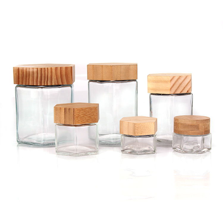 Custom 70ml 180ml 280ml 380ml wide mouth food grade hexagonal glass honey jar with wooden lid