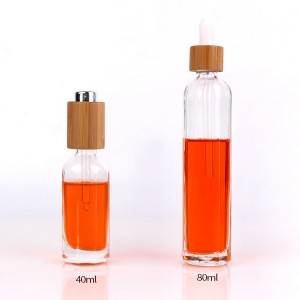 Unique 40ml round cosmetic essential oil dropper glass bottle with bamboo cap
