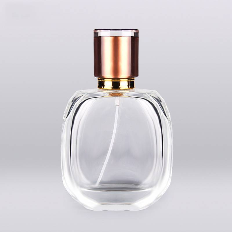 China manufacturer transparent empty  perfume glass bottle 100ml with uv luxury cap Featured Image