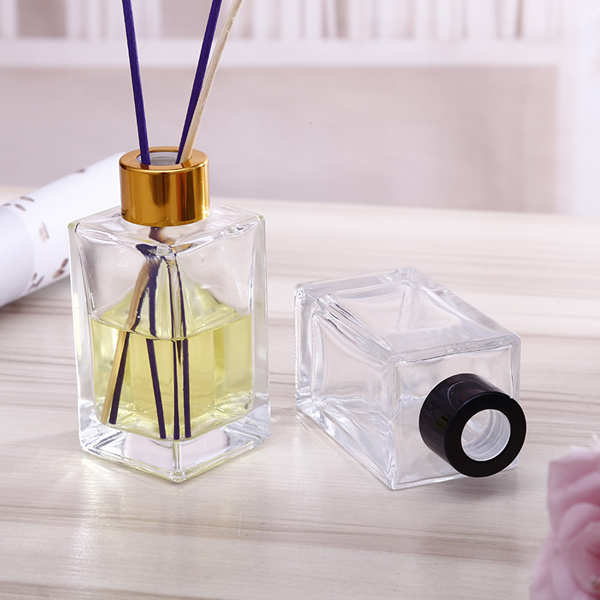 Wholesale rectangular shape crystal aroma decorative glass reed diffuser bottle with metal cap 100ml Featured Image