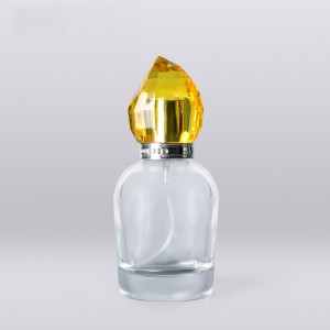 100ml luxury transparent round glass perfume bottle with golden acrylic plastic cap