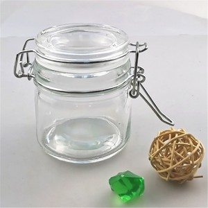 wholesale 100 ml round glass jar with flip top cap lids