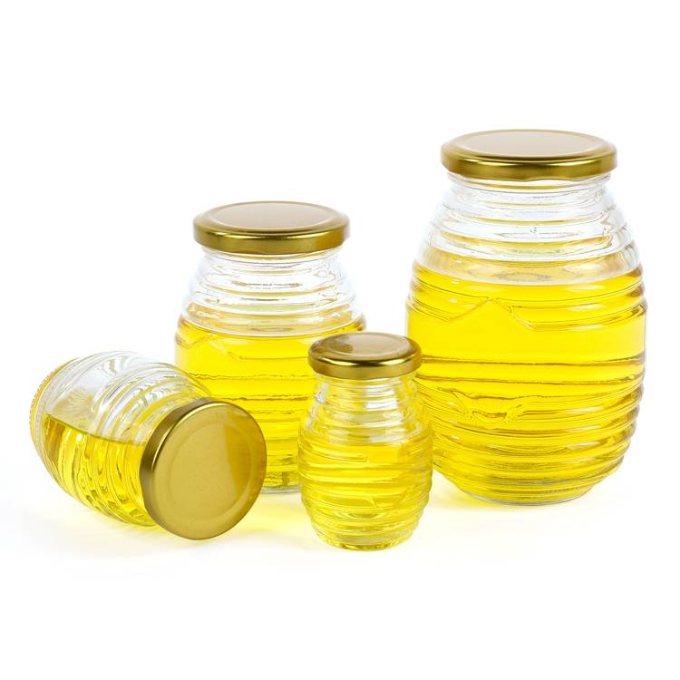 Round shaped glass honey jar with golden lid