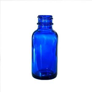 blue essential oil glass bottle with dropper cap