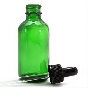 green essential oil glass bottle with dropper cap